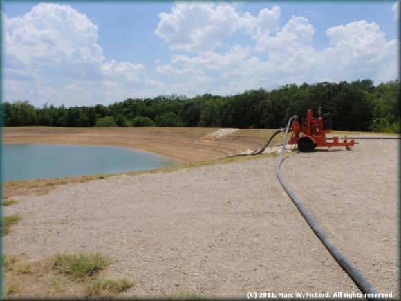 Un-lined open pit frac pond at Chesapeake KISD Site on US 287 in Arlington, Texas